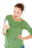 Woman laughing as she enjoys her music Royalty Free Stock Photo