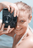 Woman laughing as she views a photo Royalty Free Stock Images