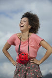 Woman laughing with a camera Royalty Free Stock Photos