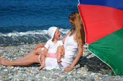 Woman and the laughing child on the beach Royalty Free Stock Images