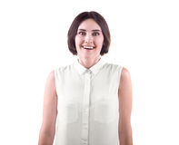 A woman is laughing and excited. A happy and crazy young woman isolated on a white background. A funny brunette and casual lady. royalty free stock photos