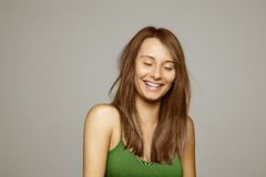 Woman laughing with eyes closed Stock Photo