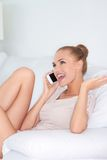 Woman laughing with friends over a mobile Stock Photography