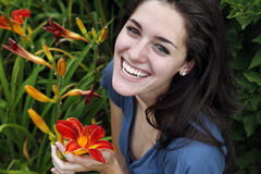 Woman laughing holding a flower Royalty Free Stock Photography