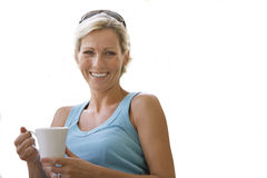 Woman laughing and holding mug of coffee, cut out Royalty Free Stock Photo