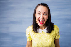 Woman laughing hysterically Royalty Free Stock Images