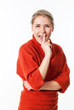 Woman laughing with index on lips for fun mystery Royalty Free Stock Photos
