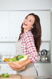 Woman laughing in kitchen Stock Photo