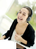 Woman laughing while listening to headphones Royalty Free Stock Photo