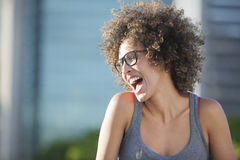Woman laughing. Oudoor with blurred background Stock Photography