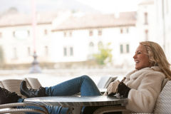 Woman laughing outdoors in Europe royalty free stock photos