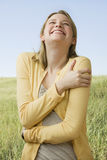 Woman Laughing Outside Stock Photography