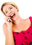 Woman laughing on the phone Royalty Free Stock Images