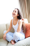 Woman laughing and playing with hair. Royalty Free Stock Photos