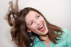 Woman laughing. Portrait of woman laughing indoor Royalty Free Stock Images
