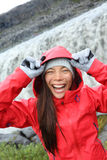 Woman laughing in raincoat by Dettifoss waterfall Royalty Free Stock Image