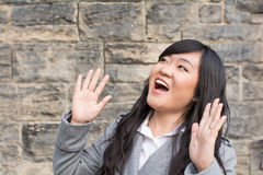 Woman laughing by a stone wall Stock Photos