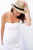 Woman laughing in summer dress and hat Stock Photography