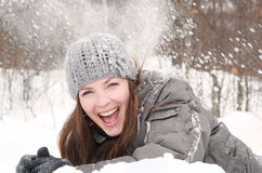 Woman laughing during winter Stock Image