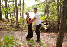 A woman laughs at her husband in the forest Royalty Free Stock Images