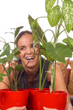 Woman laughs between plants Royalty Free Stock Photos
