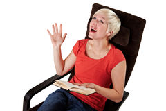 Woman laughs while reading a book Royalty Free Stock Photos