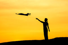Woman launches toy plane. Royalty Free Stock Image