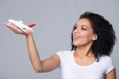 Woman launching airplane Stock Images