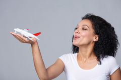 Woman launching airplane Royalty Free Stock Images