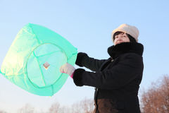 Woman in launching big baloon, half body, winter Stock Image