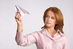 Woman launching paper plane up royalty free stock photo