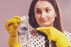 Woman launder shady money. Illegal cash, dollars bill, corruption, manipulation concept.  royalty free stock photography