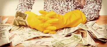Money laundering illegal cash, dollars bill, shady money, corru. Woman launder shady money illegal cash, dollars bill, corruption, manipulation royalty free stock image