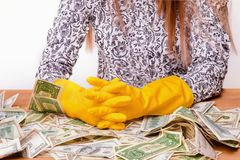 Money laundering illegal cash, dollars bill, shady money, corru. Woman launder shady money illegal cash, dollars bill, corruption, manipulation stock image