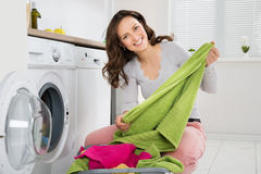 Woman Laundering Clothes In Washer Royalty Free Stock Images