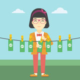 Woman laundering money vector illustration. Stock Image