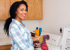 Woman laundry Stock Images