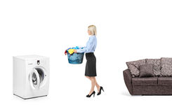 Woman with a laundry basket Stock Photos