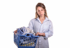 Woman with a laundry basket for ironing Royalty Free Stock Image