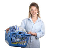 Woman with a laundry basket for ironing Stock Photos