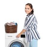 Woman with laundry basket near washing machine Stock Photos