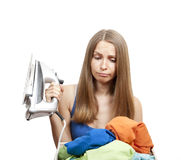 Woman with laundry and iron. Young woman with laundry, housework royalty free stock image