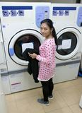 woman in the laundry room Stock Photography