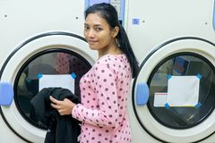 Woman in the laundry room Royalty Free Stock Images