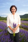 Woman with  lavander flowers Stock Photos