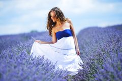 Woman on lavender field Royalty Free Stock Image