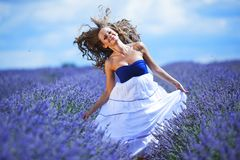 Woman on lavender field Stock Images