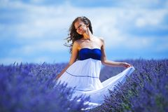 Woman on lavender field Stock Photos