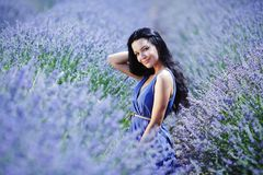 Woman on a lavender field Stock Photos