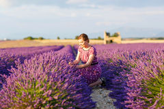 Woman in lavender fields in Provence, France stock photo